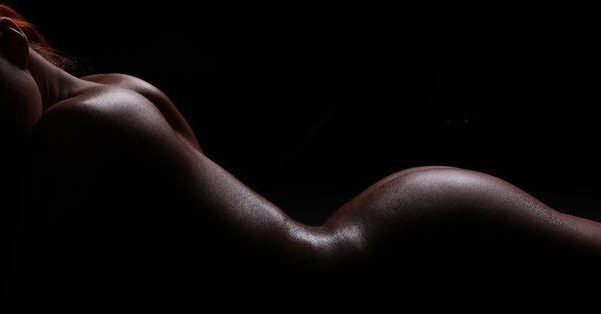 38232958 - silhouette of a nude female